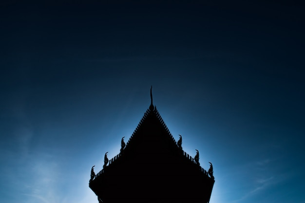 Silhouette of thai temples in the blue sky background