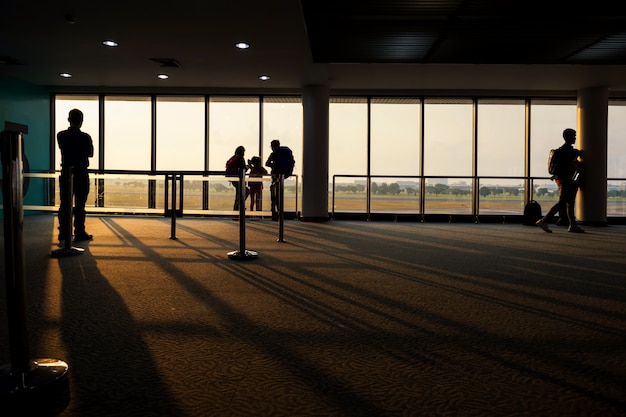Silhouette tourist at airtport terminal at sunrise