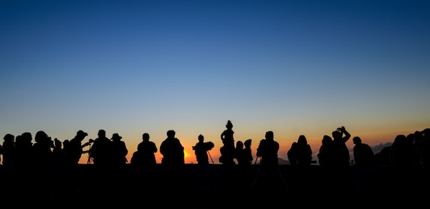 Silhouette tourists and photographers with beautiful sunrise