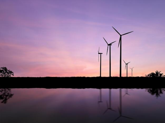 Силуэт ветряных турбин на фоне закатного неба