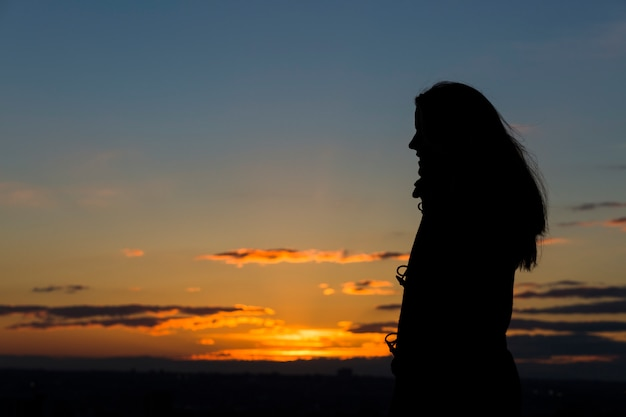 Silhouette of a woman during beautiful sunset