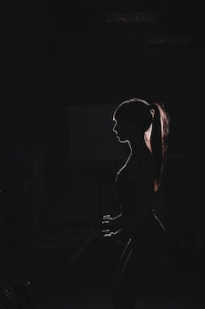 Silhouette of woman in gym