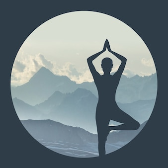 Silhouette of a woman practicing yoga on a mountain background in a circle