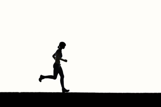 シルエットの女性ランニングまたは女性ランナー
