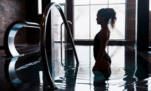 Silhouette of woman in spa