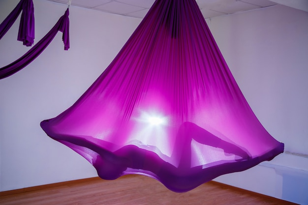 Silhouette of a woman using hammock