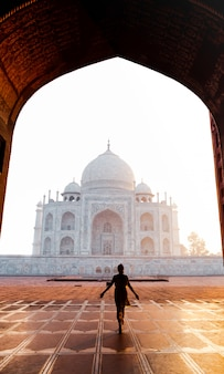 Silhouette woman walking near taj mahal in agra india.
