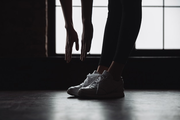 woman trying to touch toes