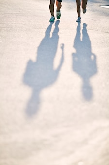 Silhouettes of athletes in the street