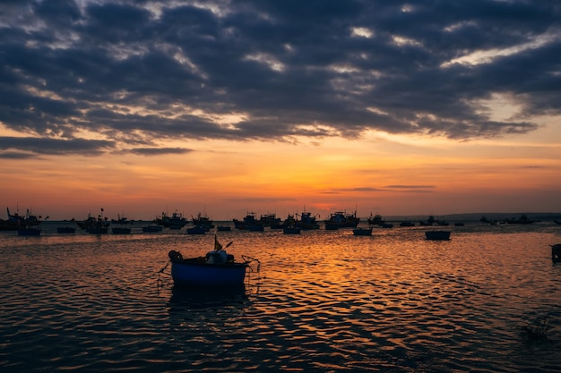 Silhouettes of boats for fishing on the sea in vietnam