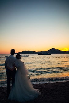 Silhouettes of couples near sveti stefan