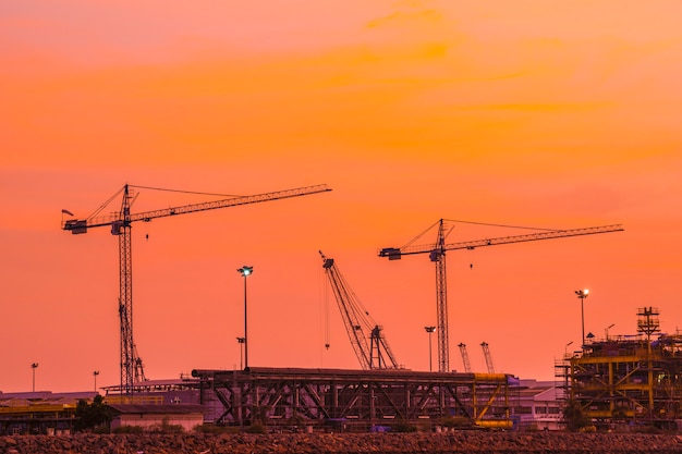 Silhouettes of crane the evening sky.