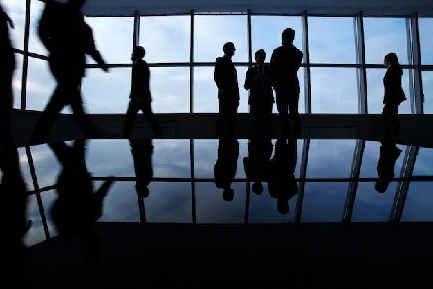 Silhouettes of employees in the office