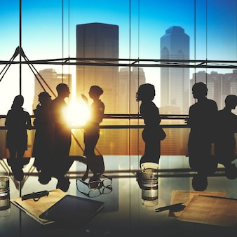 Silhouettes of Business People Brainstorming Inside the Office