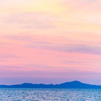 Silhouettes of mountains with pink sky