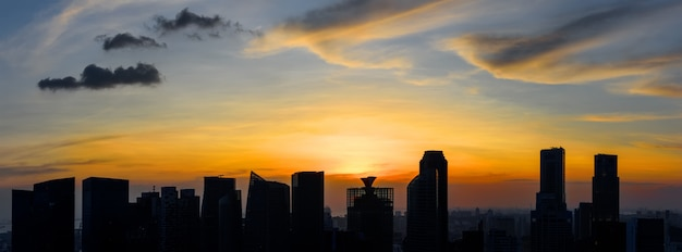 Silhouettes of singapore skyscrapers at colorful sunset