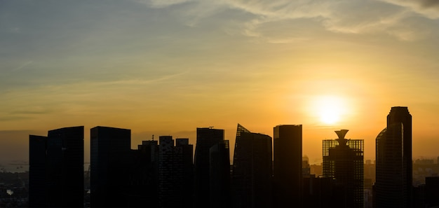 Silhouettes of singapore skyscrapers at sunset