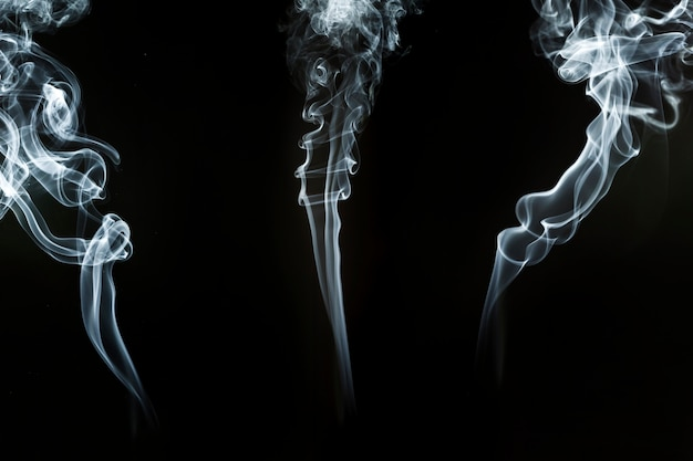 Silhouettes of smoke with spiral shapes