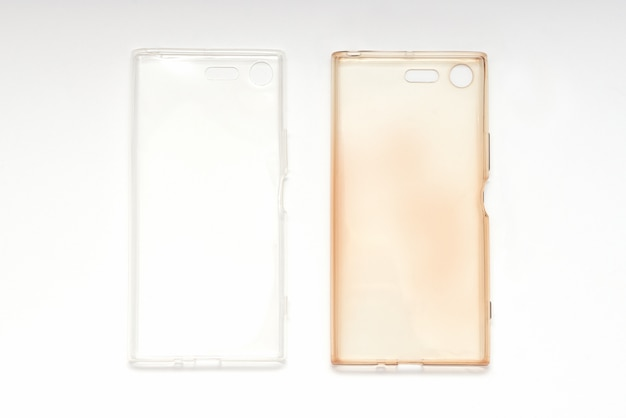 Silicone case on smartphone, damaged and brand new on white