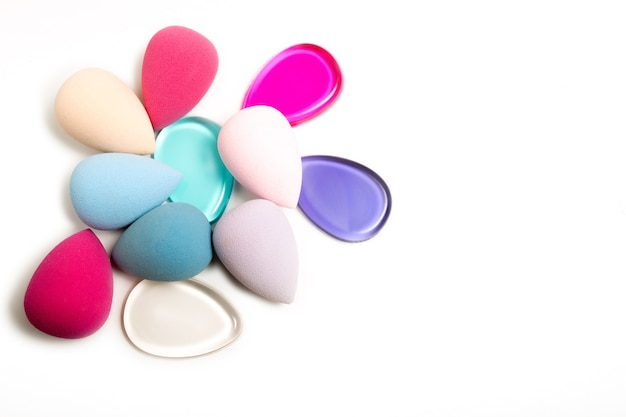Silicone foundation sponge and beauty blenders on a white background. space for text