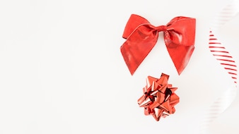 Silk bow set and striped ribbon on white backdrop