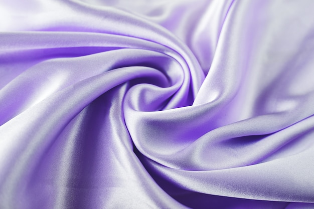 Silk cloth background pink satin fabric waves sheets abstract texture
