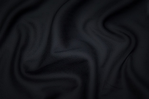 Silk or cotton or wool fabric tissue. dark gray or black color. texture, background, pattern.