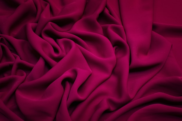 Silk fabric the color is crimson texture background