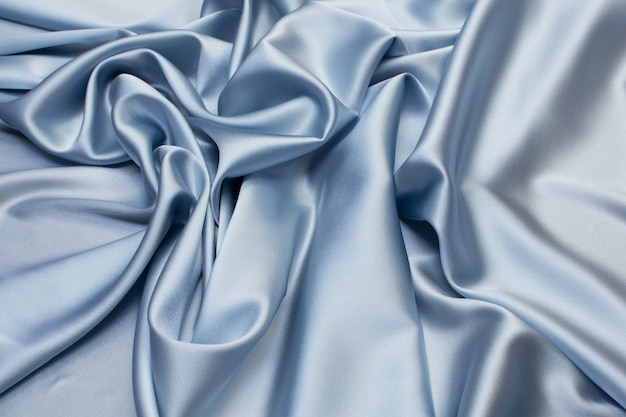 Silk fabric, satin. the color is blue. texture,