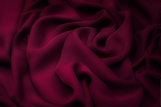 실크 직물. 색상은 진홍색입니다. 질감, 배경, 패턴입니다.
