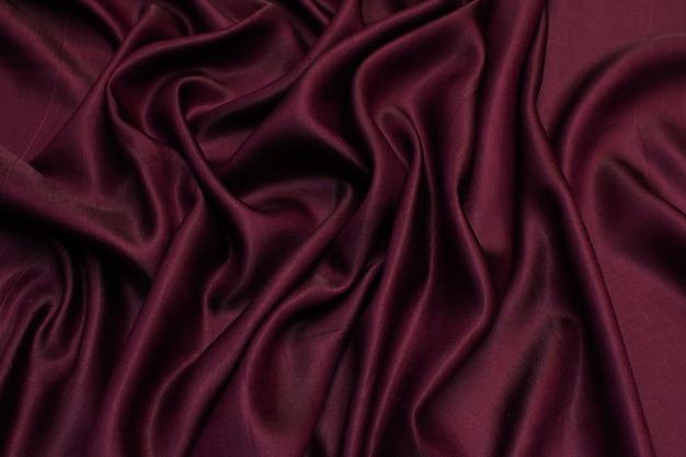 Шелковая ткань с вискозой. цвет бордовый. текстура,