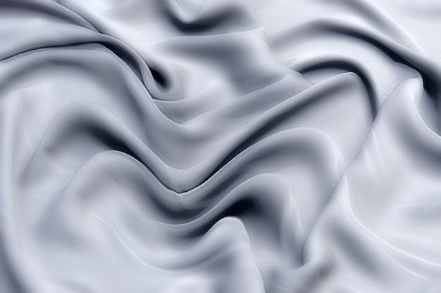 실크 또는면 직물 티슈. 진한 회색 또는 검은 색. 질감, 배경, 패턴.
