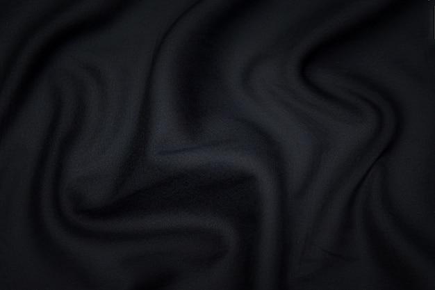 실크 또는 면 또는 양모 직물 조직. 짙은 회색 또는 검정색. 질감, 배경, 패턴입니다.