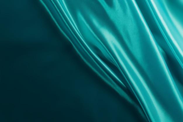 실크 또는 새틴 고급 천 패브릭 질감 부드럽고 우아한 물결 모양의 청록색, 추상적 인 배경 디자인