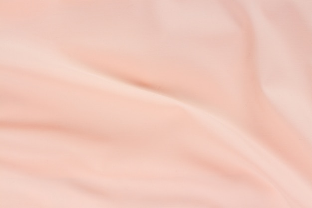 Silk pink fabric waves background full frame texture
