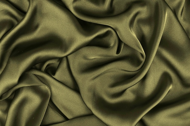 Silk or satin luxury fabric texture can use as abstract background. top view.