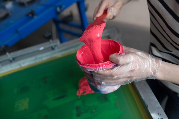 Silk screen printing. serigraphy. color paints and fabric. plastisol paint.