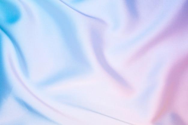 파스텔 무지개 빛깔의 홀로그램 색상의 실크 반짝 패브릭 질감