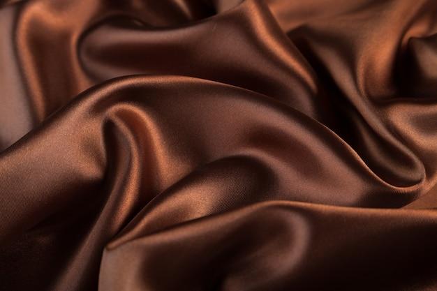 シルクテキスタイルの背景。茶色の質感