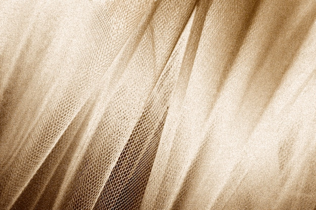 Silky gold fabric snakeskin textured