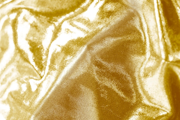 Silky golden fabric textured background