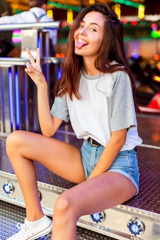 Silly woman posing at bumper cars