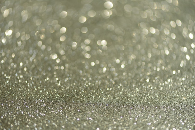 Silver abstract bokeh lights. defocused background with copy space.
