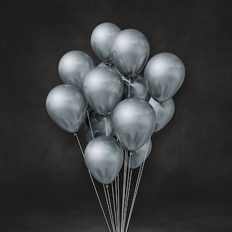 Silver balloons bunch on a black wall background. 3d illustration render