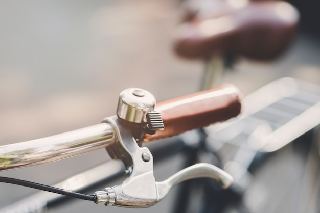 Silver bell on bicycle's handle