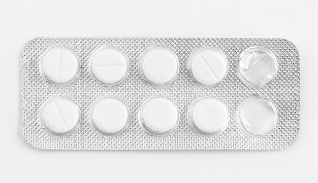 Silver blister packs pills isolated on white