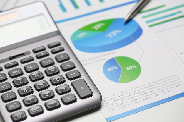 Silver calculator and financial statistics on clipboard