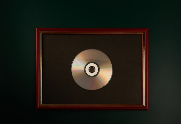 Silver cd in a wooden photo frame