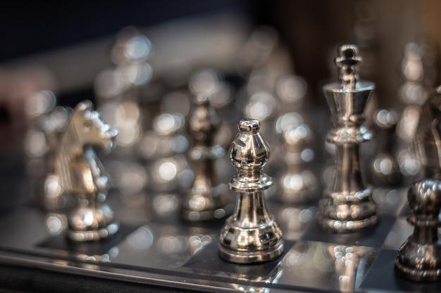 Silver chess model on board strategic game