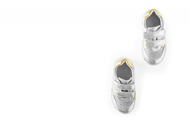 The silver children's sports shoes isolated on a white background